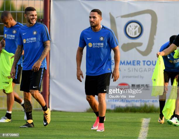 Mauro Icardi and Danilo D'Ambrosio of FC Internazionale chat during a FC Interazionale training session at Suning training center on July 19 2017 in...