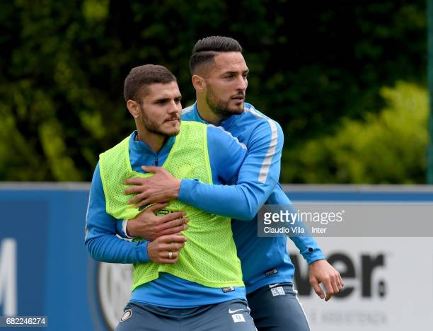 Mauro Icardi and Danilo D'Ambrosio of FC Internazionale compete for the ball during FC Internazionale training session at Suning Training Center at...