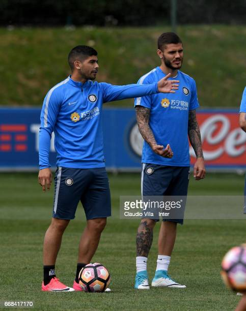 Mauro Icardi and Ever Banega of FC Internazionale chat during FC Internazionale training session at Suning Training Center at Appiano Gentile on...