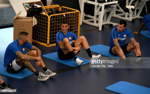 Mauro Icardi Matias Vecino and Gary Medel of FC Internazionale chat during a training session at Suning Training Center at Appiano Gentile on August...