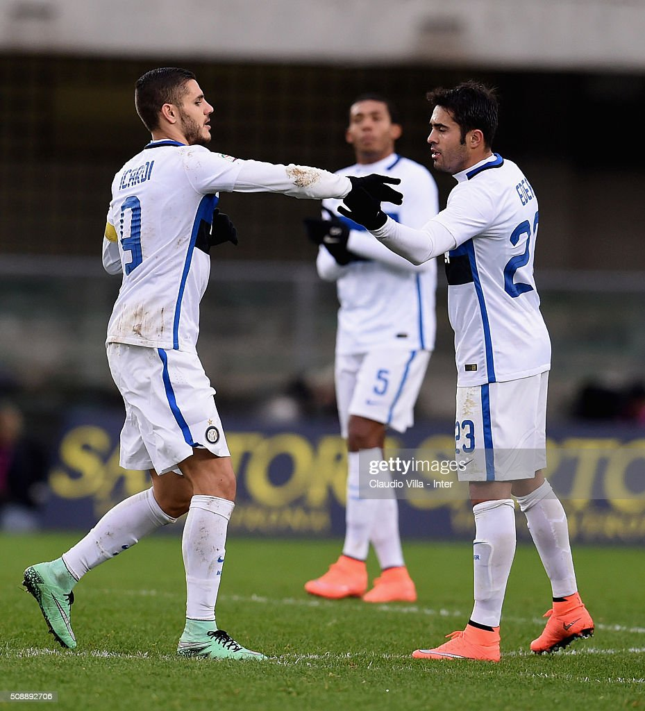 Mauro Icardi of FC Internazionale (L) after scoring the second goal during the Serie A match between Hellas Verona FC and FC Internazionale Milano at Stadio Marc'Antonio Bentegodi on February 7, 2016 in Verona, Italy.