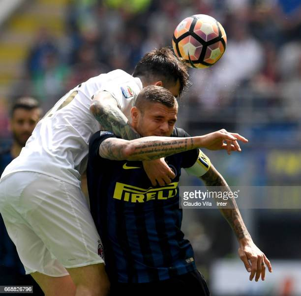 Mauro Icardi of FC Internazionale and Alessio Romagnoli of AC Milan compete for the ball during the Serie A match between FC Internazionale and AC...