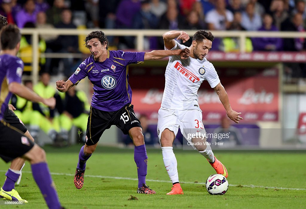 Mauro Icardi of FC Internazionale (R) and Danilo D'Ambrosio of ACF Fiorentina compete for the ball during the Serie A match between ACF Fiorentina and FC Internazionale Milano at Stadio Artemio Franchi on October 5, 2014 in Florence, Italy.