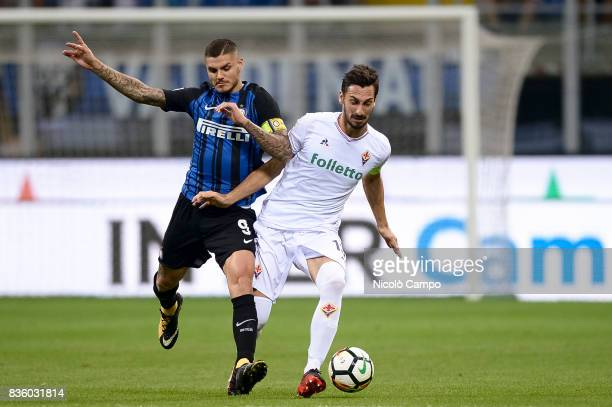 Mauro Icardi of FC Internazionale and Davide Astori of ACF Fiorentina compete for the ball during the Serie A football match between FC...
