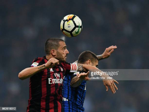 Mauro Icardi of FC Internazionale and Leonardo Bonucci of AC Milan compete for the ball during the Serie A match between FC Internazionale and AC...