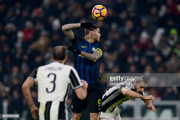 Mauro Icardi of FC Internazionale and Leonardo Bonucci of Juventus FC compete for a header during the Serie A football match between Juventus FC and...