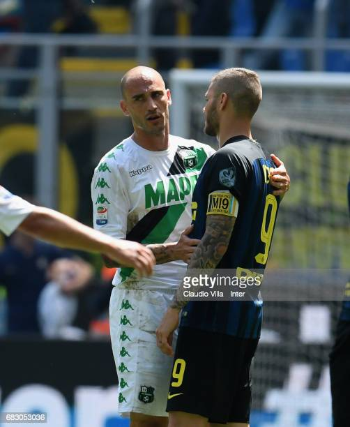 Mauro Icardi of FC Internazionale and Paolo Cannavaro of US Sassuolo chat during the Serie A match between FC Internazionale and US Sassuolo at...