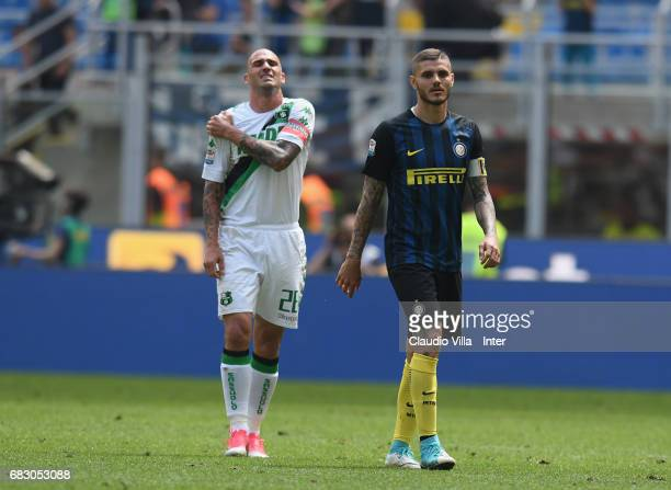 Mauro Icardi of FC Internazionale and Paolo Cannavaro of US Sassuolo look on during the Serie A match between FC Internazionale and US Sassuolo at...
