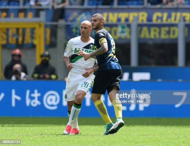Mauro Icardi of FC Internazionale and Paolo Cannavaro of US Sassuolo compete during the Serie A match between FC Internazionale and US Sassuolo at...