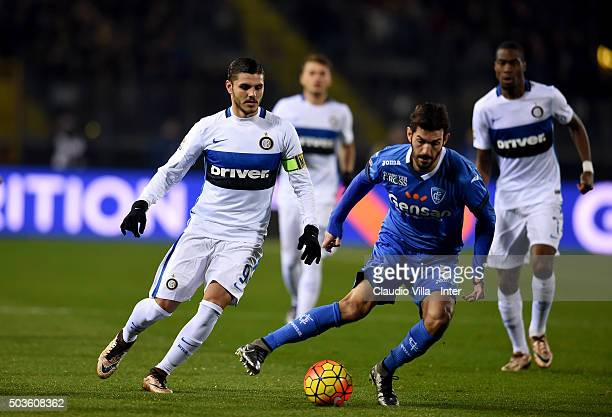 Mauro Icardi of FC Internazionale and Riccardo Saponara of Empoli FC compete for the ball during the Serie A match between Empoli FC and FC...