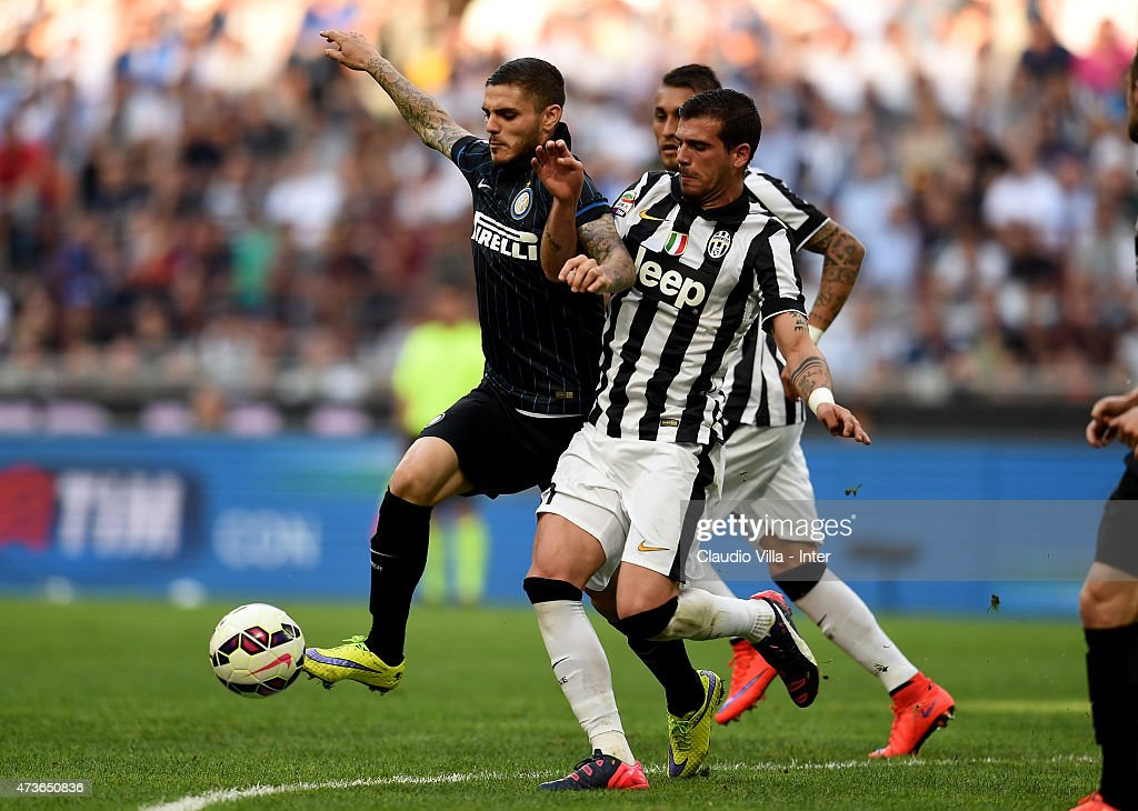 Mauro Icardi of FC Internazionale (L) and Stefano Sturaro of Juventus during the Serie A match between FC Internazionale Milano and Juventus FC at Stadio Giuseppe Meazza on May 16, 2015 in Milan, Italy.