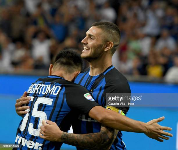 Mauro Icardi of FC Internazionale celebrates with Yuto Nagatomo of FC Internazionale after scoring the opening goal during the Serie A match between...