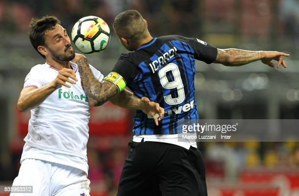 Mauro Icardi of FC Internazionale competes for the ball with Davide Astori of ACF Fiorentina during the Serie A match between FC Internazionale and...