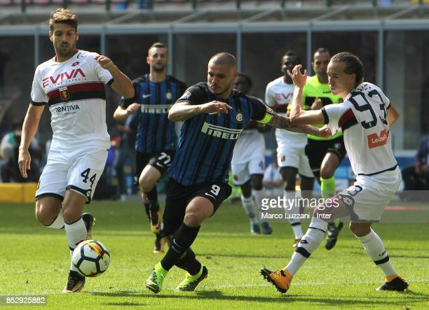 Mauro Icardi of FC Internazionale competes for the ball with Diego Laxalt of Genoa CFC during the Serie A match between FC Internazionale and Genoa...
