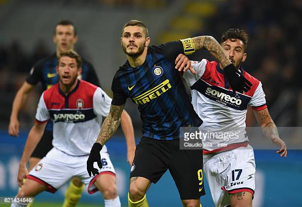 Mauro Icardi of FC Internazionale competes for the ball with Federico Ceccherinii of FC Crotone during the Serie A match between FC Internazionale...