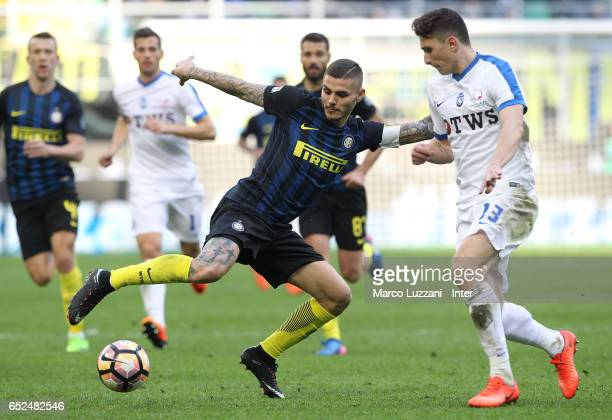 Mauro Icardi of FC Internazionale competes for the ball with Mattia Caldara of Atalanta BC during the Serie A match between FC Internazionale and...