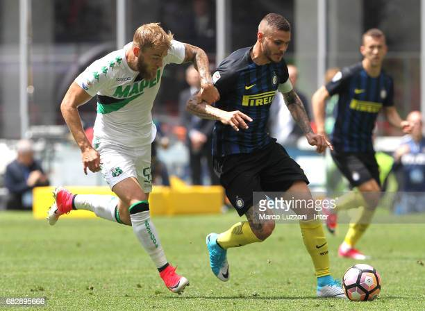 Mauro Icardi of FC Internazionale competes for the ball with Timo Letschert of US Sassuolo during the Serie A match between FC Internazionale and US...