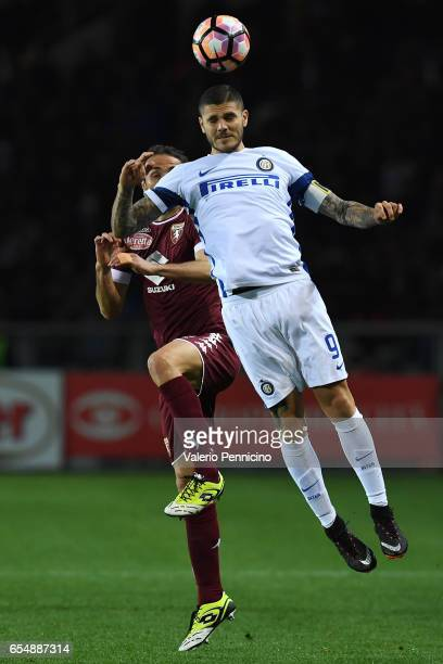 Mauro Icardi of FC Internazionale goes up with Emiliano Moretti of FC Torino during the Serie A match between FC Torino and FC Internazionale at...