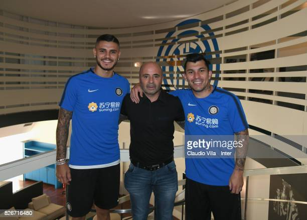 Mauro Icardi of FC Internazionale Head coach Argentina Jorge Sampaoli and Gary Medel of FC Internazionale pose for a photo at Appiano Gentile on...