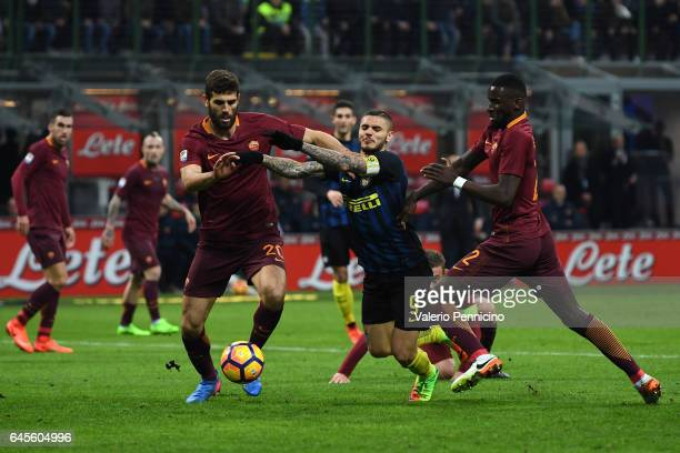 Mauro Icardi of FC Internazionale is challenged by Federico Fazio and Antonio Rudiger of AS Roma during the Serie A match between FC Internazionale...