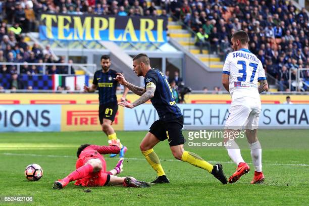 Mauro Icardi of FC Internazionale is fouled for a penalty by Etrit Belisha of Atalanta BC during the Serie A match between FC Internazionale and...