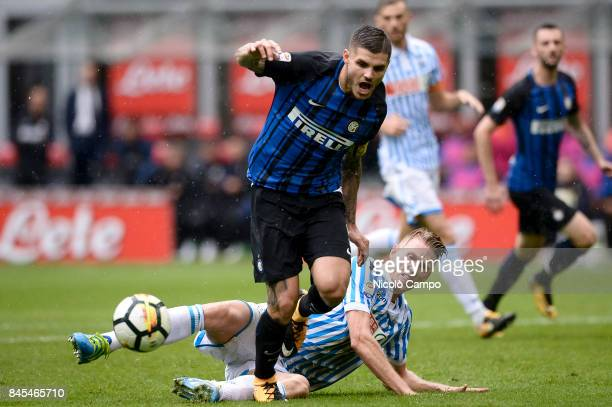 Mauro Icardi of FC Internazionale is tackled by Bartosz Salamon of Spal during the Serie A football match between FC Internazionale and Spal FC...