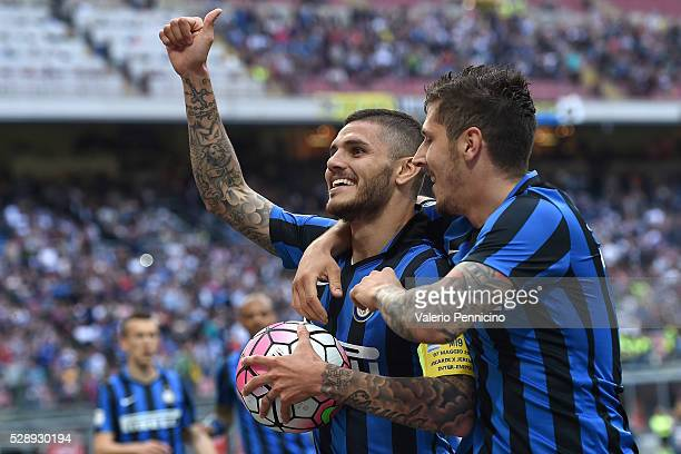 Mauro Icardi of FC Internazionale Milano celebrates after scoring the opening goal with team mate Stevan Jovetic during the Serie A match between FC...