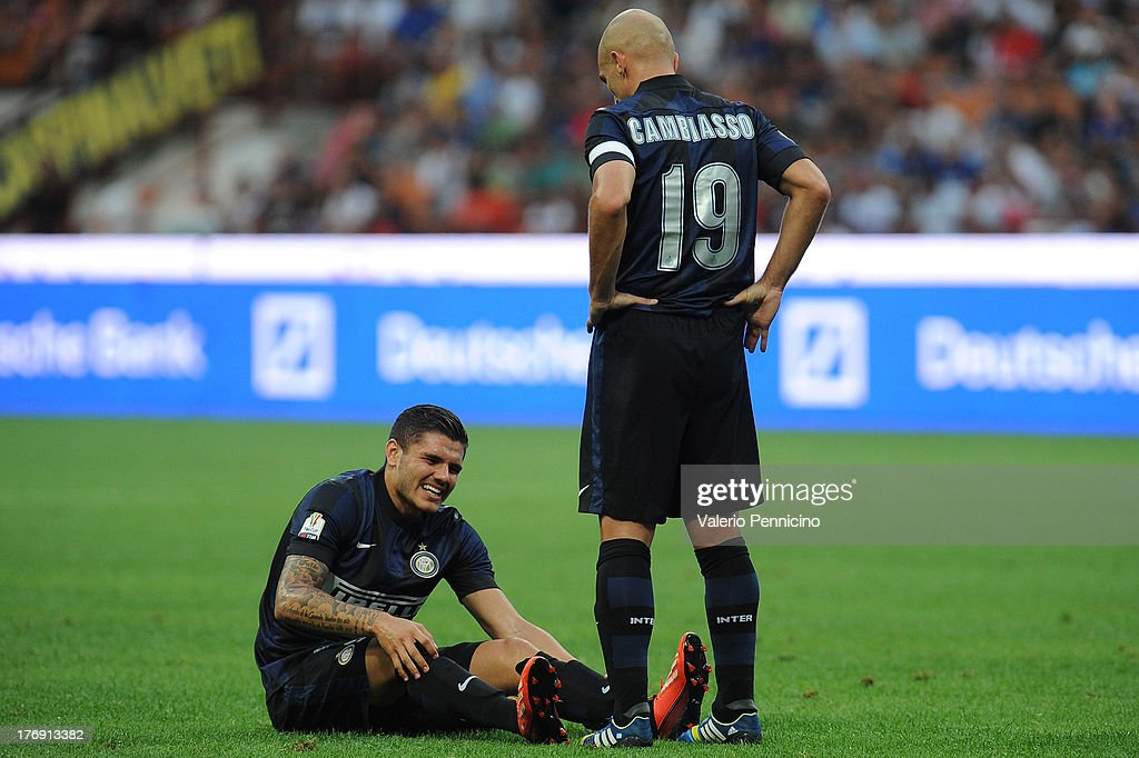 Mauro Icardi (L) of FC Internazionale Milano lies injured during the TIM cup match between FC Internazionale Milano and AS Cittadella at Stadio Giuseppe Meazza on August 18, 2013 in Milan, Italy.
