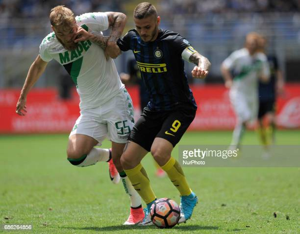 Mauro Icardi of Inter player and Timo Letschert of Sassuolo player during the Serie A match between FC Internazionale and US Sassuolo at Stadio...