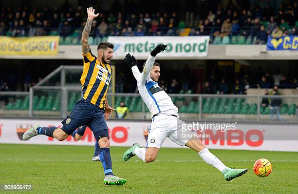 Mauro Icardi of Internazionale Milano competes with Eros Pisano of Hellas Verona during the Serie A match between Hellas Verona FC and FC...