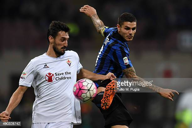 Mauro Icardi of Internazionale Milano jumps for the ball as Davide Astori of Fiorentina tackles during the Serie A match between FC Internazionale...