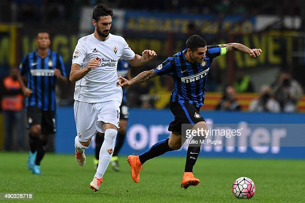 Mauro Icardi of Internazionale Milanois challenged by Davide Astori of Fiorentina during the Serie A match between FC Internazionale Milano and ACF...