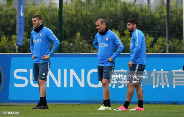 Mauro Icardi Rodrigo Sebastian Palacio and Ever Banega of FC Internazionale look on during FC Internazionale training session at Suning Training...