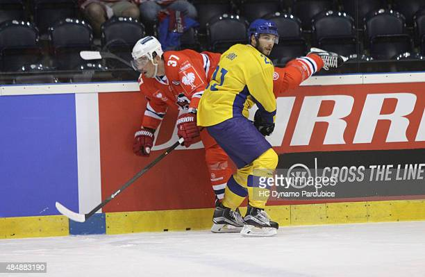 Mauro Joerg of HC Davos checks Petr Sykora of HC Dynamo during the Champions Hockey League group stage game between Dynamo Pardubice and HC Davos on...