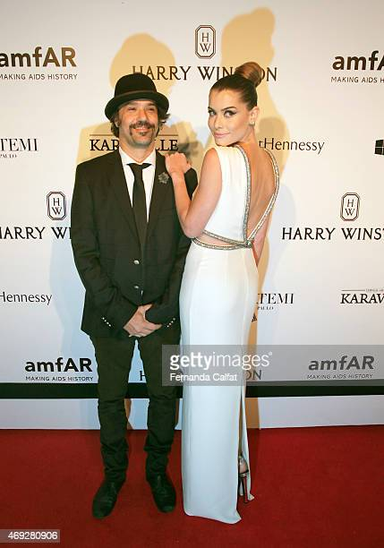 Mauro Lima and Alinne Moraes attend the 5th Annual amfAR Inspiration Gala at the home of Dinho Diniz on April 10 2015 in Sao Paulo Brazil
