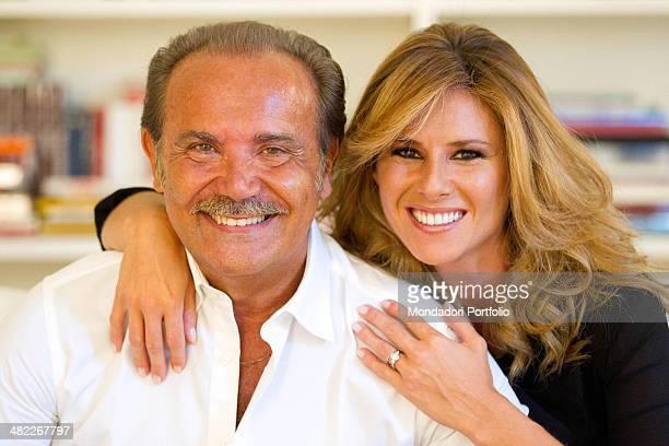 Mauro Masi italian executive chief of Consap smiles next his girlfriend and Italian TV presenter Ingrid Muccitelli July 15 2011