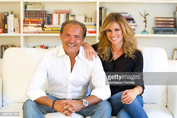 Mauro Masi the italian executive chief of Consap smiles sitting on a couch next to his girlfriend and Italian TV presenter Ingrid Muccitelli July 15...