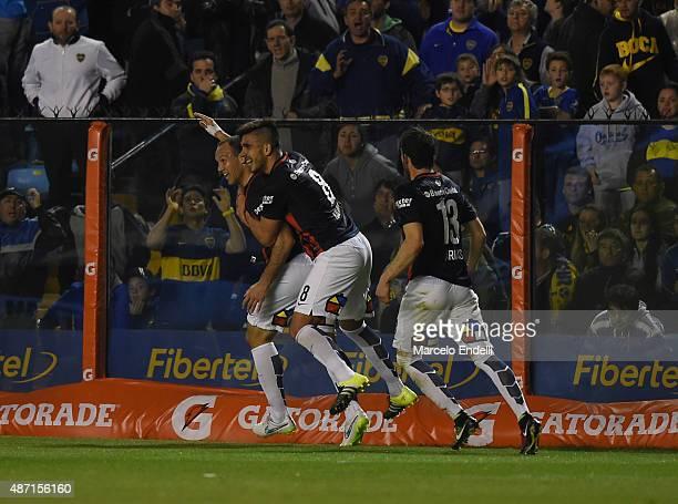 Mauro Matos of San Lorenzo celebrates with Enzo Kalinski and Ramiro Arias after scoring the opening goal during a match between Boca Juniors and San...