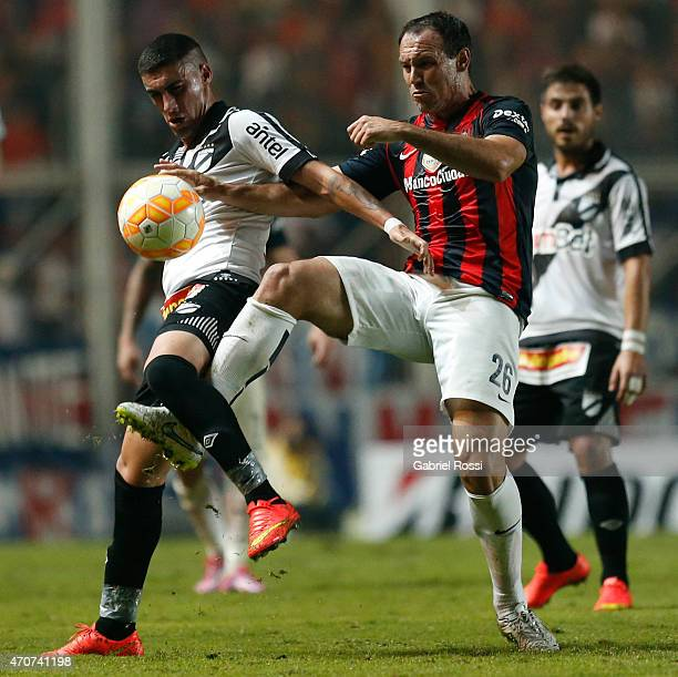 Mauro Matos of San Lorenzo fights for the ball with Emiliano Ghan of Danubio during a match between San Lorenzo v Danubio as part of Copa Bridgestone...