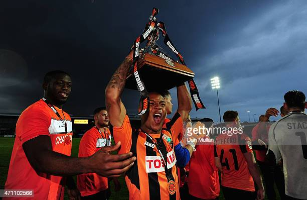 Mauro Vilhete of Barnet celebrates with the trophy after his side win promotion during the Vanarama Football Conference League match between Barnet...