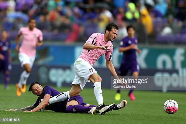 Mauro Zarate of ACF Fiorentina battles for the ball with Franco Vazquez of US Citta di Palermo during the Serie A match between ACF Fiorentina and US...