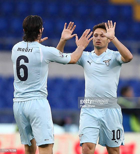 Mauro Zarate of SS Lazio celebrates with teammate Stefano Mauri after scoring the opening goal of the Serie A match between SS Lazio and AC Cesena at...