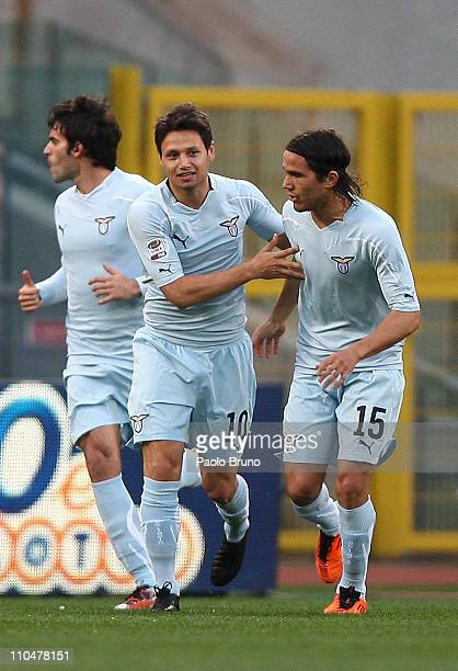 Mauro Zarate of SS Lazio celebrates with teammates after scoring the opening goal of the Serie A match between SS Lazio and AC Cesena at Stadio...