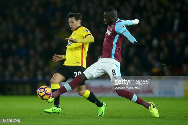 Mauro Zarate of Watford holds off Cheikhou Kouyate of West Ham United during the Premier League match between Watford and West Ham United at Vicarage...