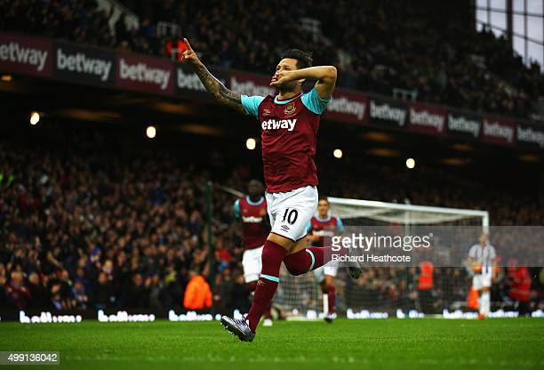 Mauro Zarate of West Ham United celebrates as he scores their first goal from a free kick during the Barclays Premier League match between West Ham...