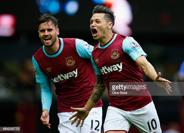 Mauro Zarate of West Ham United celebrates scoring his team's first goal with his team mate Carl Jenkinson during the Barclays Premier League match...