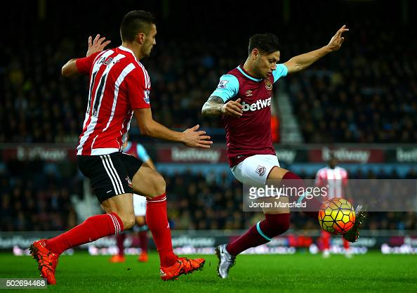 Mauro Zarate of West Ham United holds off Dusan Tadic of Southampton during the Barclays Premier League match between West Ham United and Southampton...