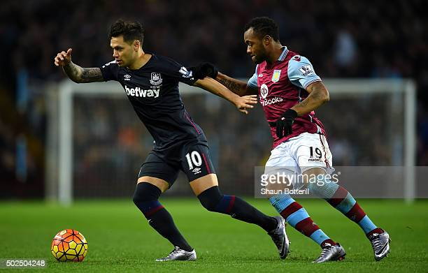 Mauro Zarate of West Ham United holds off Jordan Ayew of Aston Villa during the Barclays Premier League match between Aston Villa and West Ham United...
