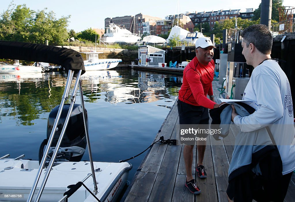 Maury Collins rents out his 22foot Boston Whaler to Bob Sideropoulos of Pembroke as part of a peertopeer boat sharing site Boatbound in East Boston...