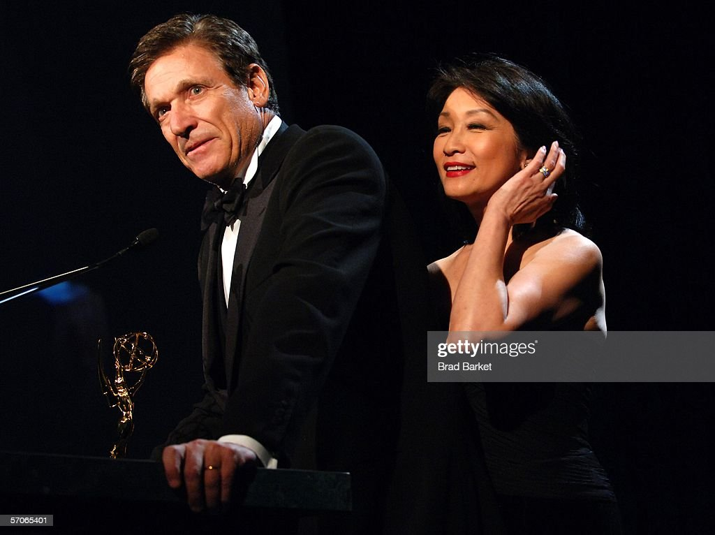 Maury Povich speaks with wife Connie Chung at the 2006 New York Emmy Awards at the the Marriott Marquis on March 12, 2006 in New York City. Povich won the Governors award which is an honorary Emmy that recognizes outstanding achievements in the television industry.